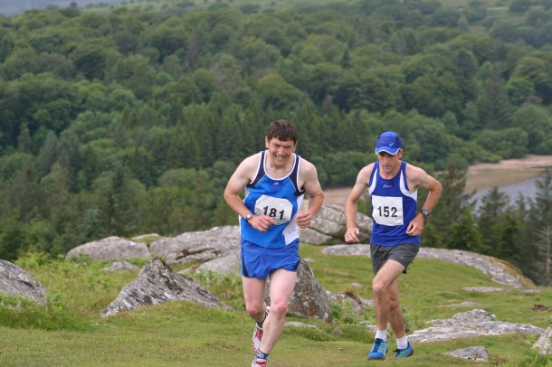 Jim Cole leads Arran Tocknell up Sheepstor
